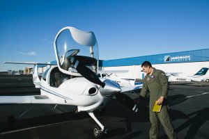 Galvin Flying Instructor Next to Aircraft