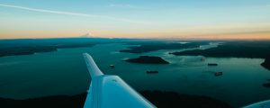 Twin Star Aircraft Mid-Air Across Scenic Northwest