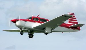 Red Mooney M20J Flying in Seattle by Flight Student